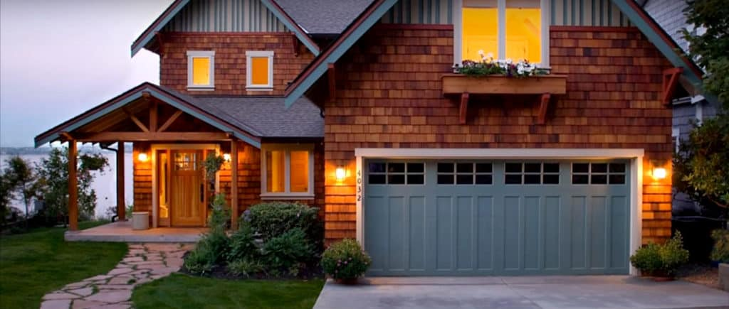Beautiful Home With Lighting and a Garage Door