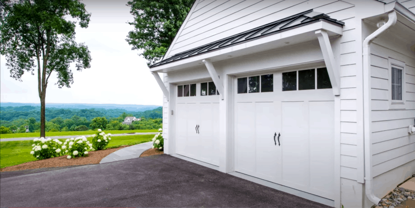 White Carriage-Style Garage Door in a Country Home